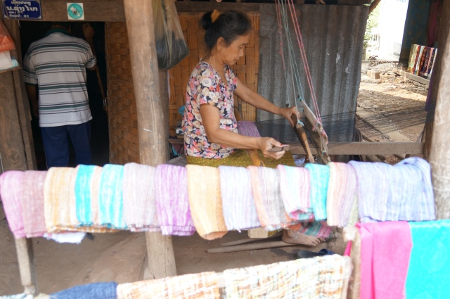 A local weaver selling her wares